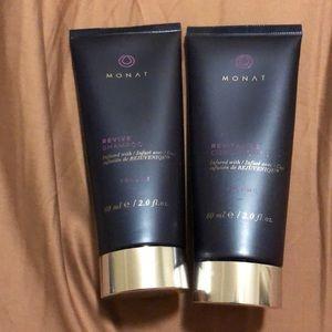 Travel sized Monat shampoo and conditioner